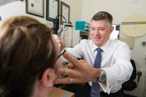 Eye tests at Focus Optometrists Sherwood QLD Simon Hurwood with a patient
