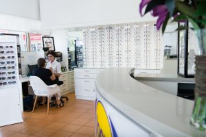 Focus Optometrists Sherwood QLD support staff with patient